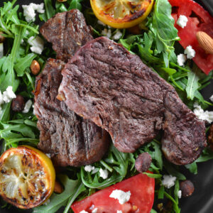 Coriander orange skirt steak with arugula and creamy smashed potatoes