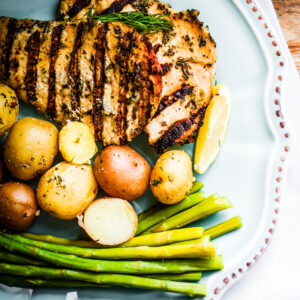Grilled lemon chicken with asparagus and tuscan potatoes