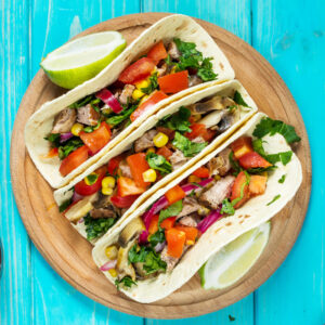 Chipotle orange pork tacos with pickled onions